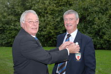 Brian (left) gives badge of office to Alf Palmer (right)
